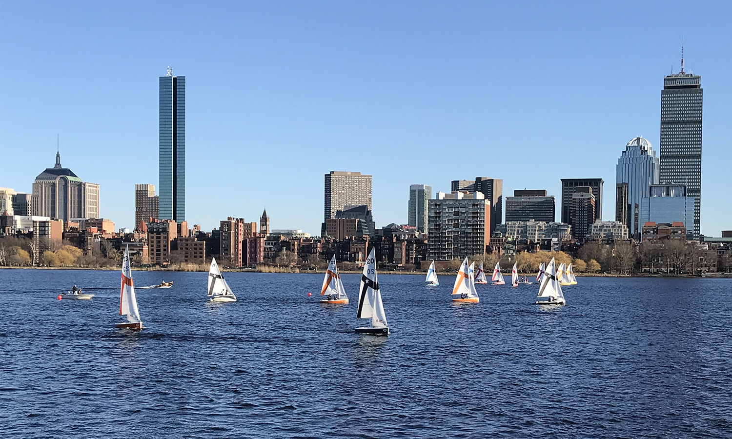 Members of the HWS Sailing team (black sails) compete during the Marchiando Team Race on the Charles River in Boston. The Colleges finished the weekend at eighth overall.