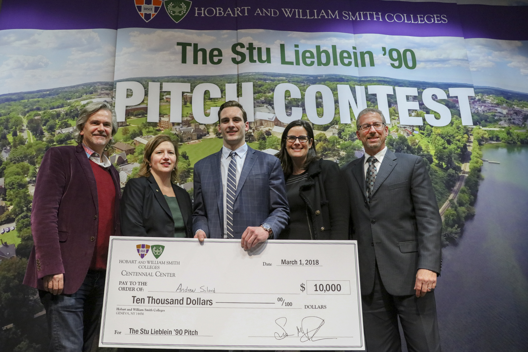 "Andrew Silard '18 is presented with the top prize, a $10,000 grant, by David A. Kaplan '83, Julie Bazan '93, Sabrina Horn '83, Suzanne B. Rutstein '95 and Michael J. Miller '83, P'09. Rizza will use the money to fund the start-up costs of ""Revolve."""