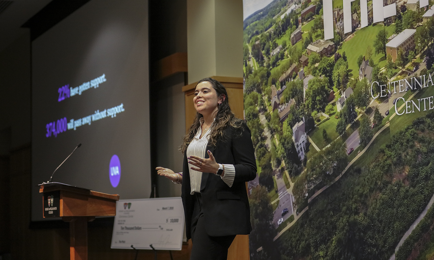 "Alexandria Knipper '21 presents ""UVA"" an online cancer connection community that uses a unique identification questionnaire to strategically connect patients, survivors and caregivers. A standing room only crowd gathered in the Vandervort on Thursday night to watch four teams present their ideas for an innovative startup."