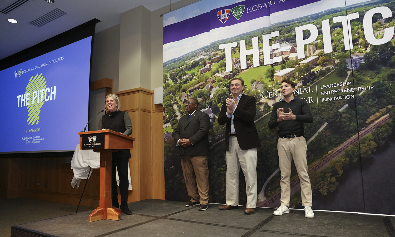 "The judges present the winner of the 2019 Pitch contest. In her remarks, Caroline Ross Galdabini '89, head of marketing at Citi Private Bank, said Zibitsker's presentation ""touched on emotion"" and had the potential to save lives. ""This individual's idea would connect with the consumer, is viable and innovative,"" she said."