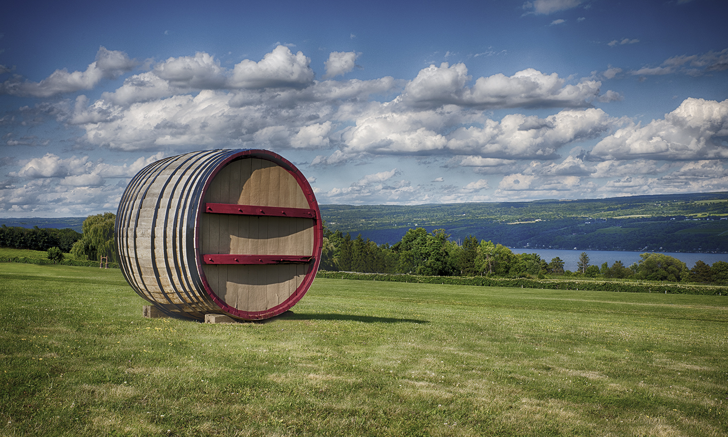 A wooden cask rests on a hill overlooking Seneca Lake in Dundee, N.Y.