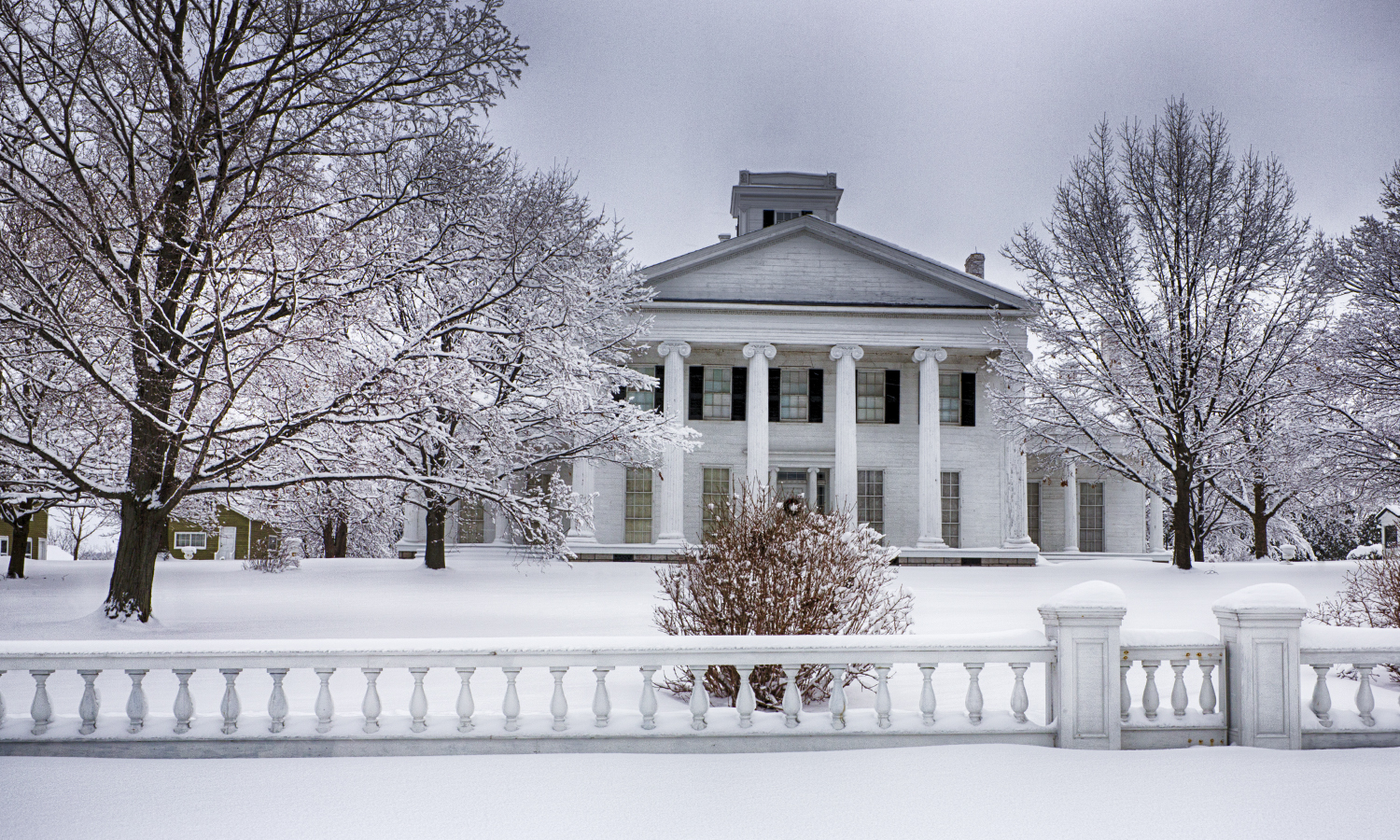 Rose Hill Mansion stands blanketed in snow in Fayette, N.Y.