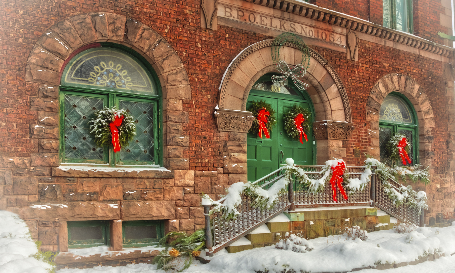 The old Collins Music Hall building is decorated for the season on historic South Main Street near campus.