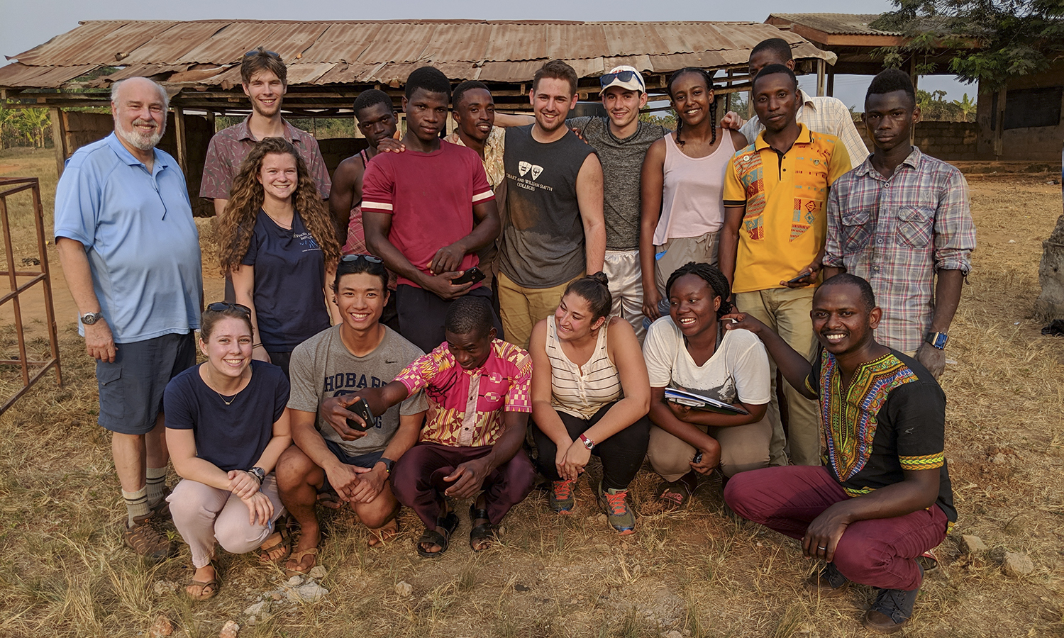 Professor of Sociology Jack Harris and students who traveled abroad during the J-term semester pose in Ghana. During the three-week program, students used asset-based community development strategies and collaboration to implement products and services in the agrarian village of NKontomire.