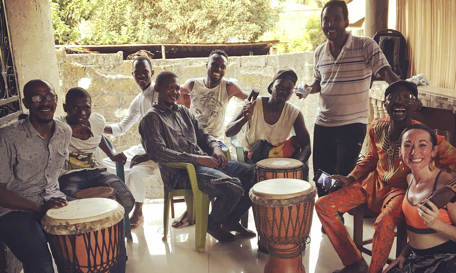 Assistant Professor of Dance Kelly Johnson travels to Conakry, Guinea, to apprentice with Master Drummer Mohamed Diaby (far left).
