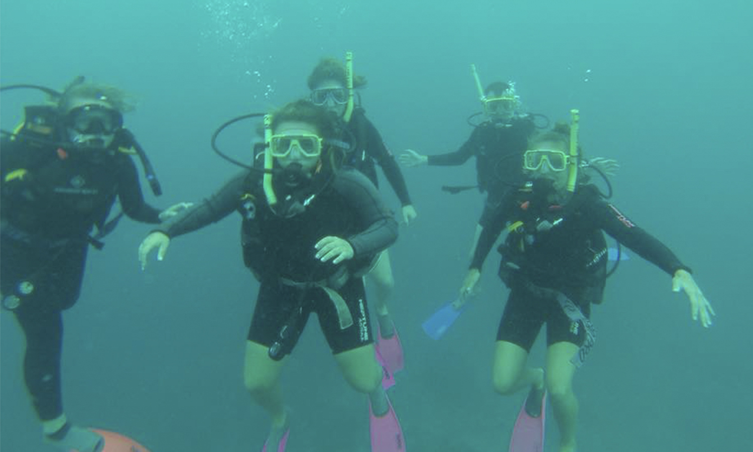 Students go scuba diving off the coast of Australia.