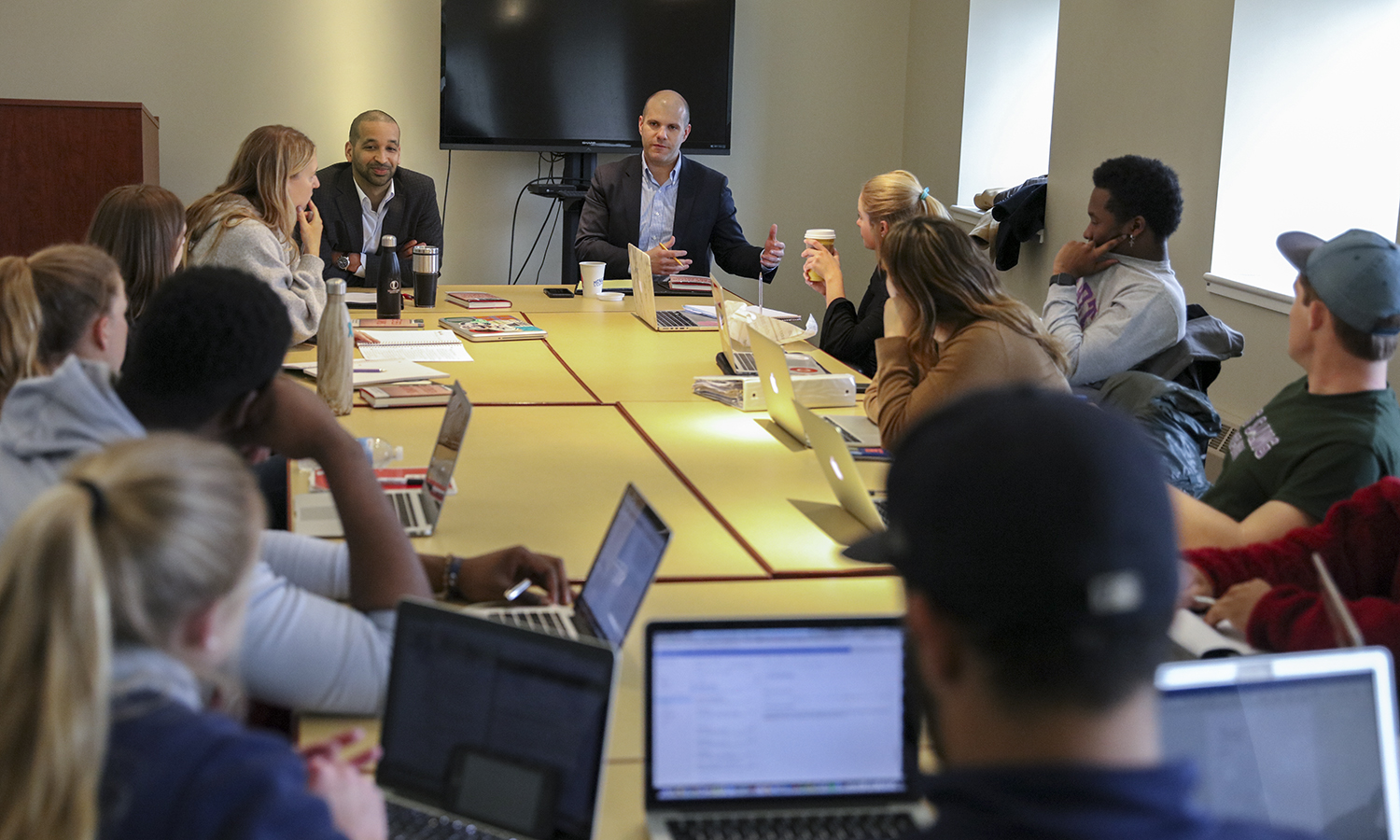 Professor of Political Science Justin Rose and Vice President and General Counsel Louis H. Guard '07 facilitate a discussion on X during X in X.