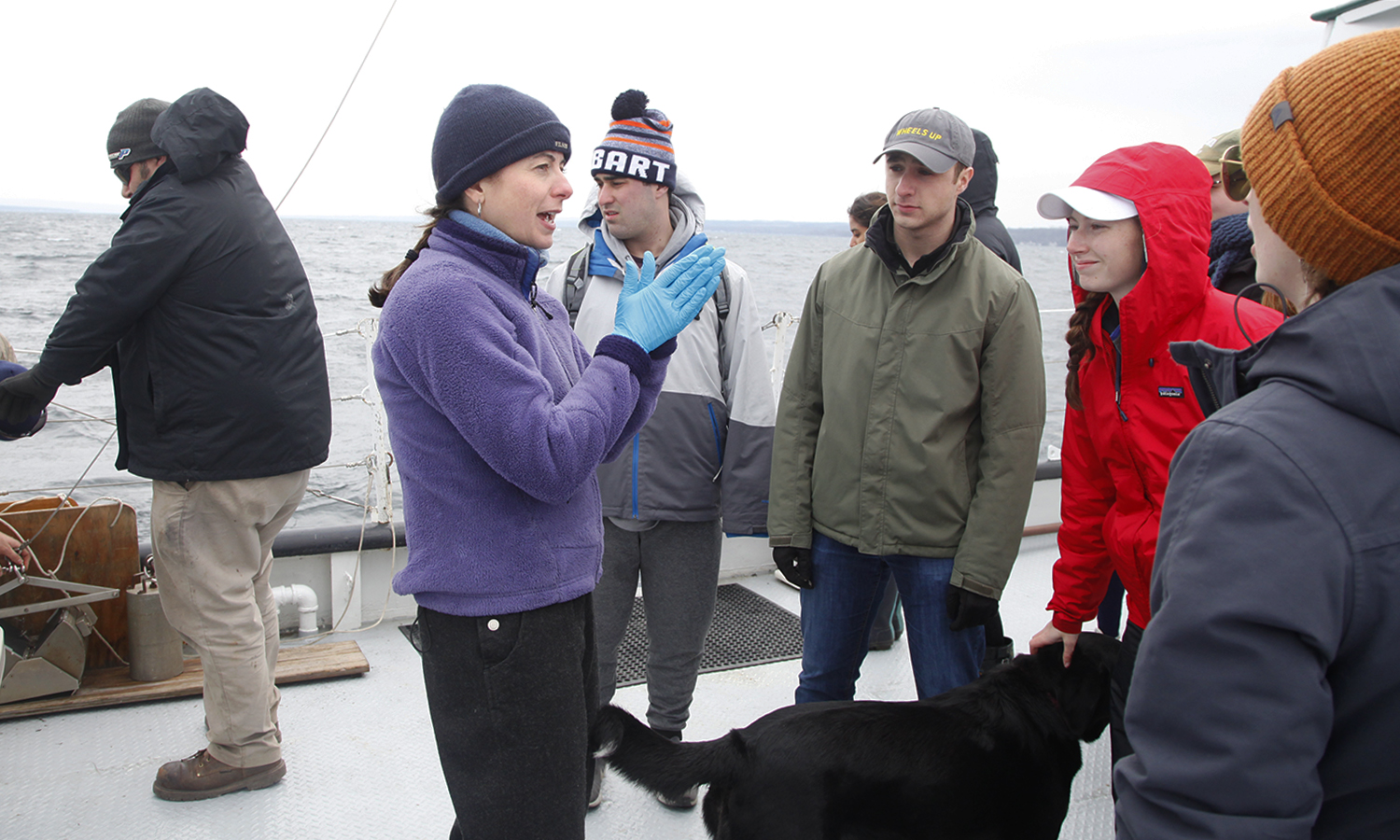 """Associate Professor of Biology Meghan Brown explains X during lab during """"invasion Biology"""" lab on the William Scandling research vessel."""