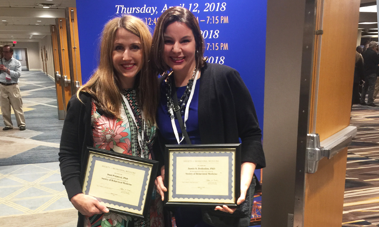Associate Professor of Health Behavior University of Alabama at Birmingham Dori Pekmezi and Associate Professor of Psychology Jamie Bodenlos pose for a photo after reciving awards during the annual conference of the Society of Behavioral Medicine.
