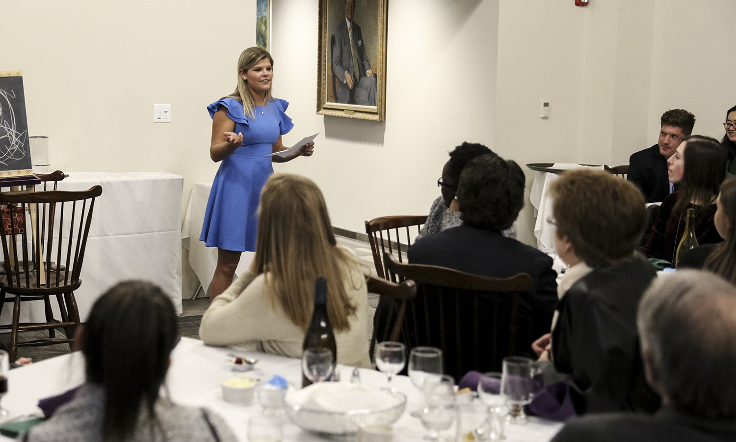 Annie O'Brien '18 speaks about her experience as a thrid-generation HWS student with fellow economics majors and staff memebrs during the Omicron Delta Epsilon National Honor Society dinner in the Common Room of Scandling Center.