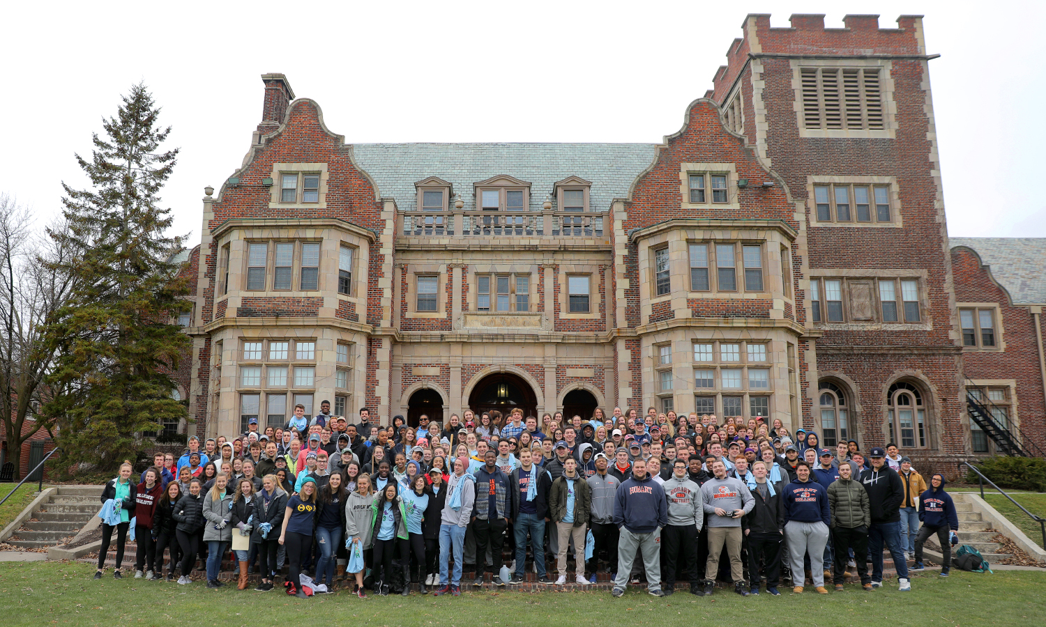 Students participating in Day of Service gather for a group photo in front of Coxe Hall. More than 400 students worked on volunteer projects throughout Geneva and the local area with projects ranging from cleaning community parks and trails, volunteering at local schools, and helping non-profit agencies with various tasks.