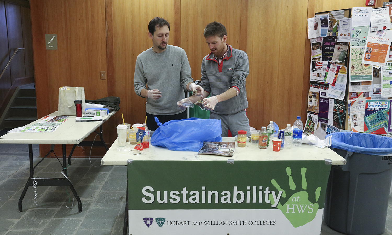 Sustainability Manager Michael Amadori (left) and Residence and Sustainability Coordinator Noah Lucas '13 perform a waste audit in Stern Hall as part of Earth Week.