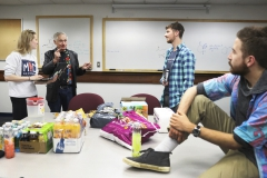 Laurel Brown 'X, Alden Ferrier 'X and Peter Banks 'X chat with Professor of Chemistry at the University of California at Berkeley Dr. Richard Saykally about his research on water in Napier Hall.
