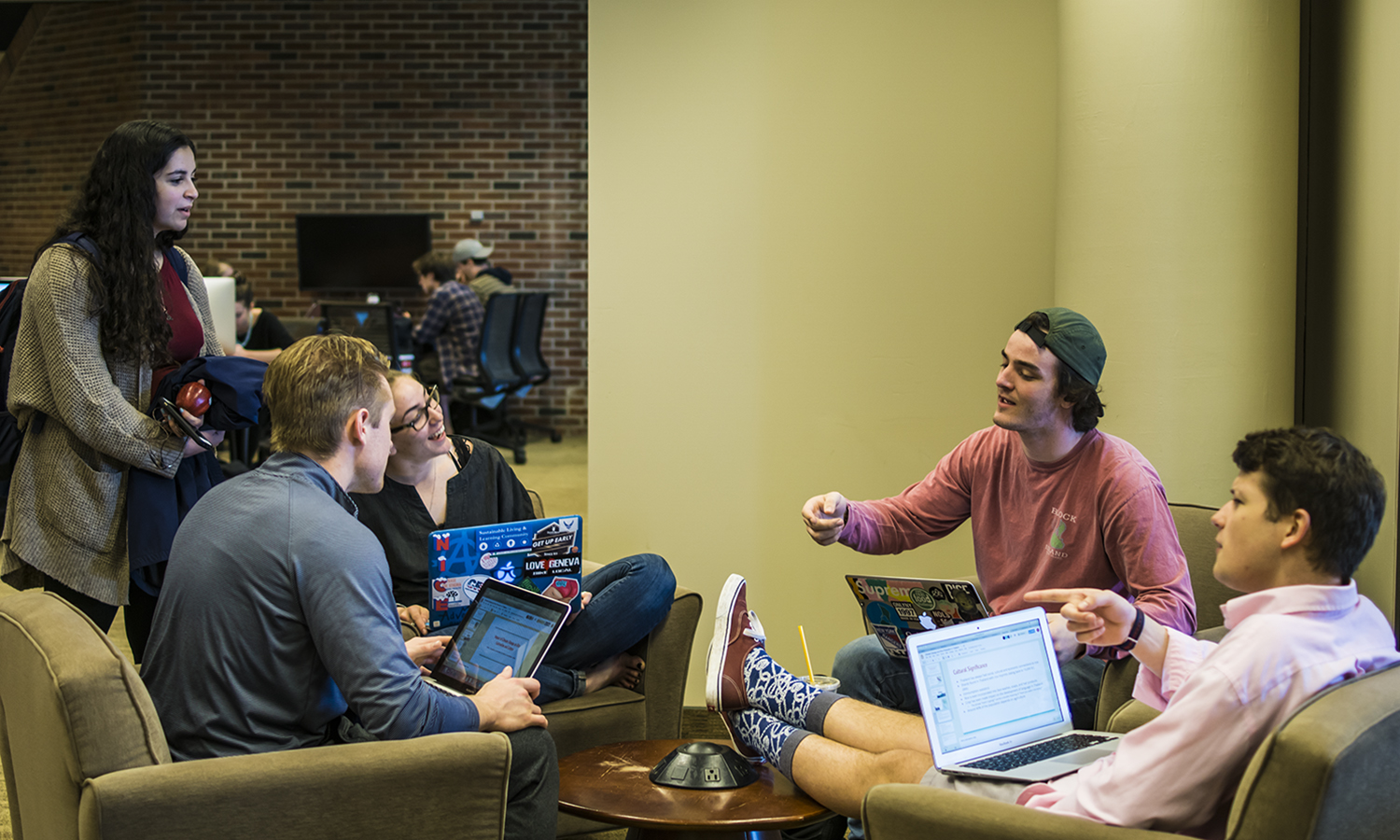 Students chat in the Rosensweig Learning Commons in Warren Hunting Smith Library.