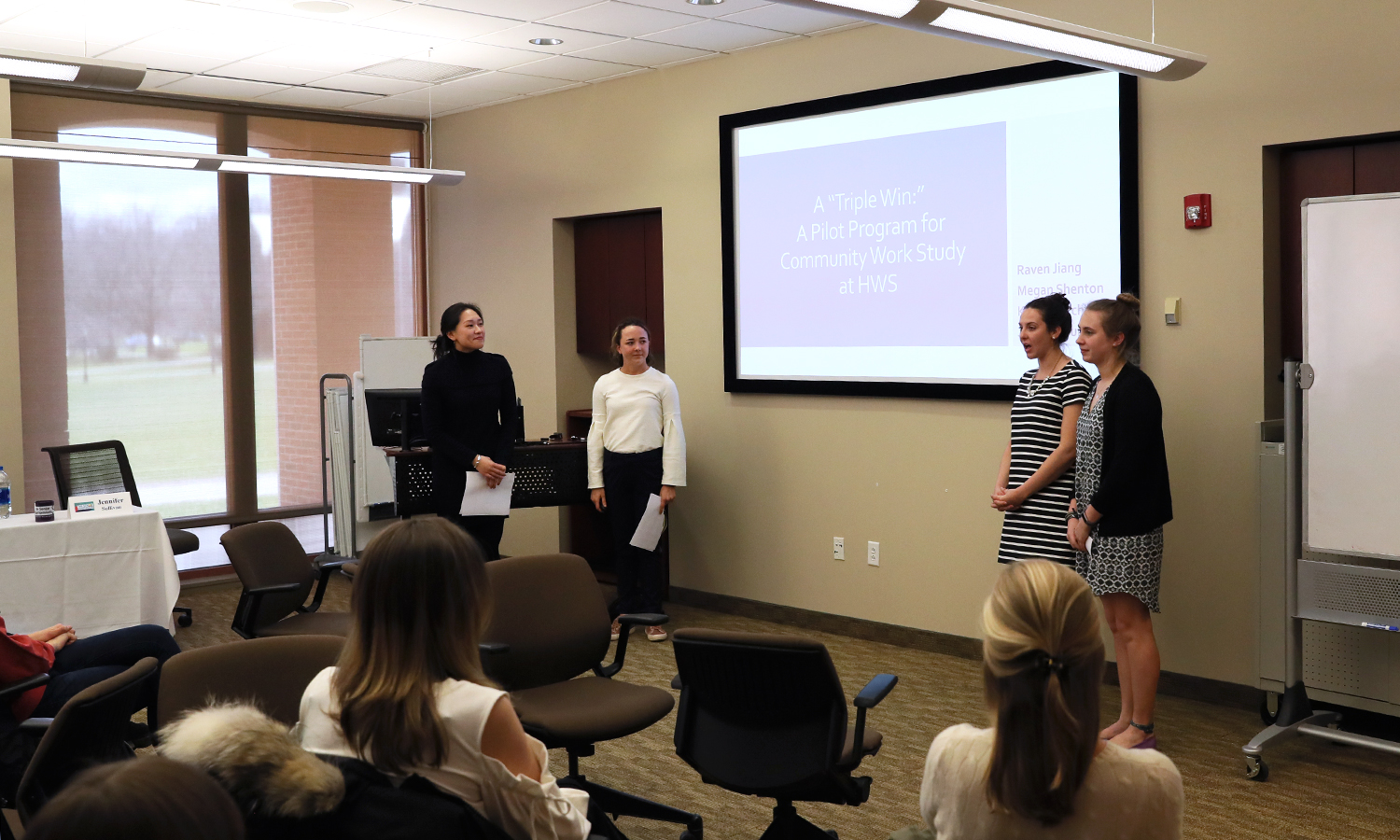 Yujun Jiang '18, Megan Shenton '18, Katherine Storch '18 and Jennifer Sullivan '18 present thier research on a pilot program for community work stdy at HWS during Senior Symposium.