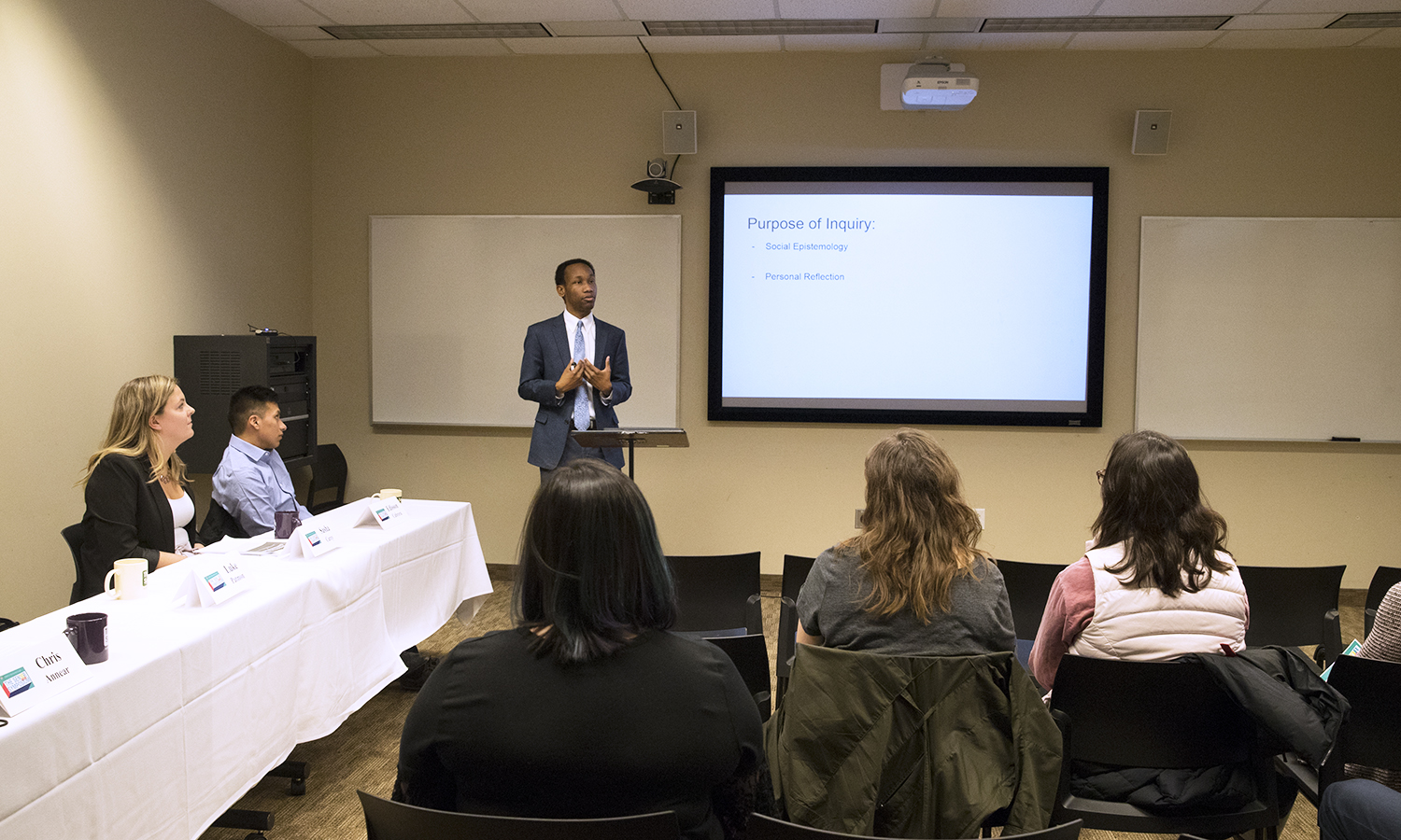 """Luke Patmore â18 discusses his Senior Symposium presentation titled """"The Seen yet Unseen Black Male Figure: The Epistemic Position of the AfricanAmerican Male in 21st Century America"""" in the Warren Hunting Smith Library Learning Studio 3."""