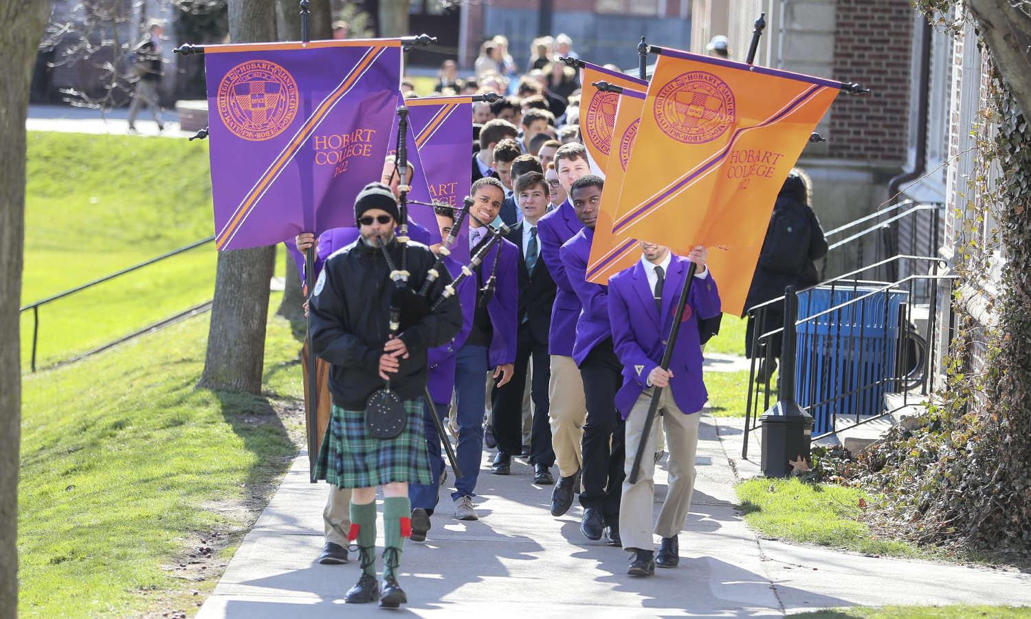 Hobart students and alums process past Medbery Hall to commence the Charter Day ceremony. One of the year's honored celebrations, Charter Day is held each spring to commemorate the granting of Hobart's charter by the State of New York on April 10, 1822.