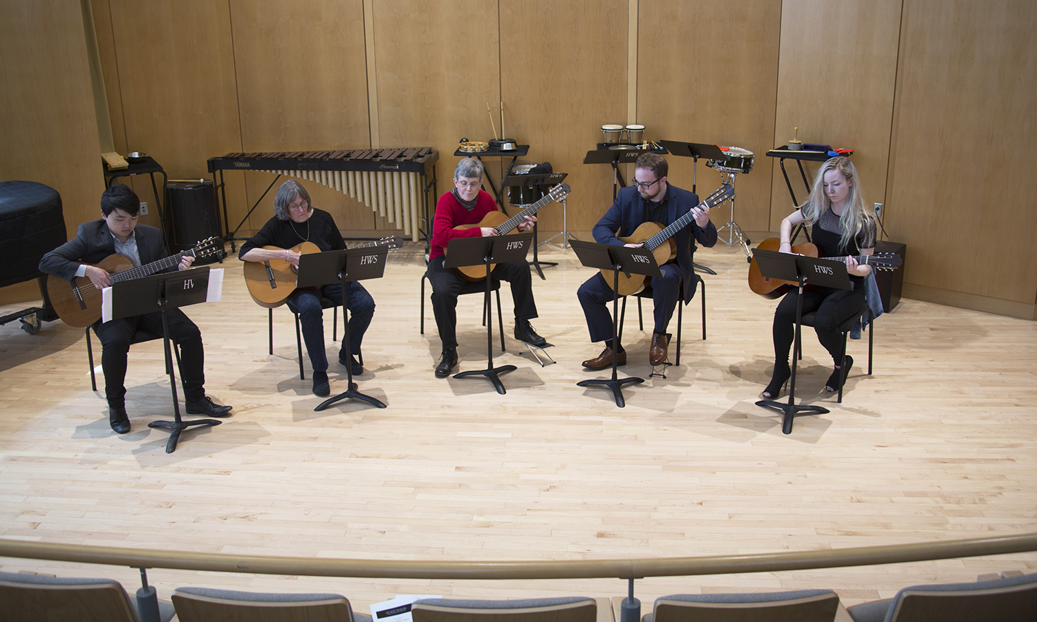 Members of the HWS Classical Guitar Ensemble perform in Froelich Hall in the Gearan Center for the Performing Arts.