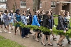 """William Smith seniors carry a laurel garland during the procession that kicks off Moving Up Day. The seniors pass the garland to juniors and all students """"moving up."""""""