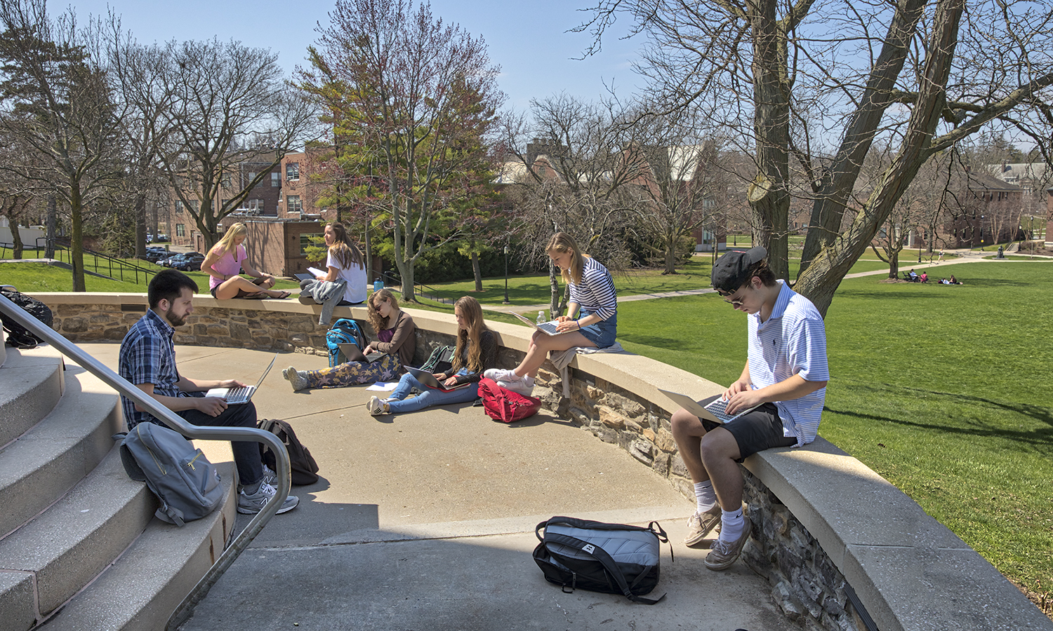 "Assistant Professor of English Alex Black discusses X during his class ""X"" outside of Trinity Hall."