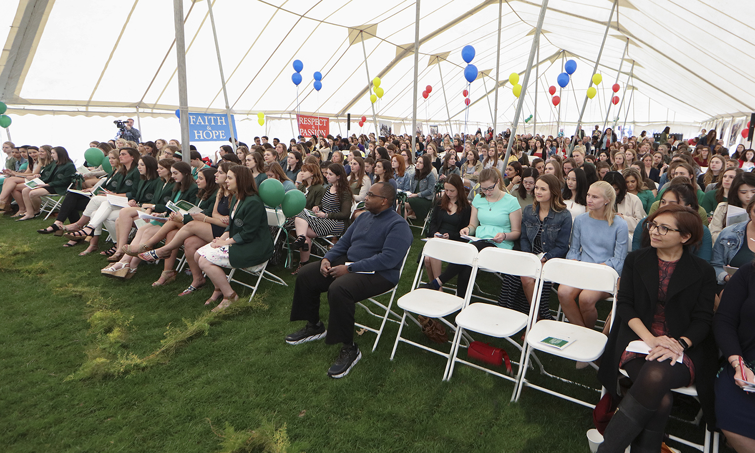 Students, faculty, staff and parents gather for the annual Moving Up Day ceremony on Stern Lawn.
