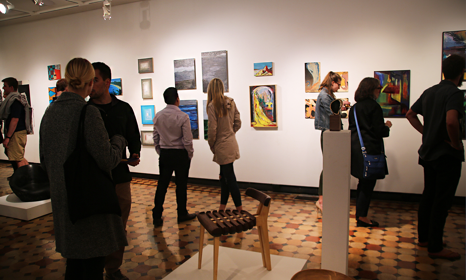 "Students, faculty and staff fill the Davis Gallery for the opening of ""Student Art and Architecture: Studio Work from 2017-2018"" in Houghton House."