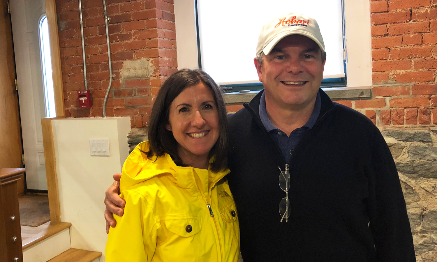 Alumni House representative Mary Kerwick takes a photo with Bruce G. Eckerson '83, P'11 during a visit to Boston, MA.