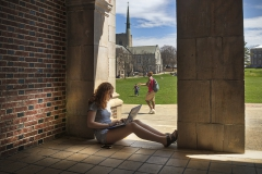 X studies on the steps of Coxe Hall on Tuesday.