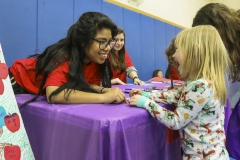 Groups of volunteering students created arts and crafts and interacted with children at the Geneva Community Center/Boys and Girls Club.