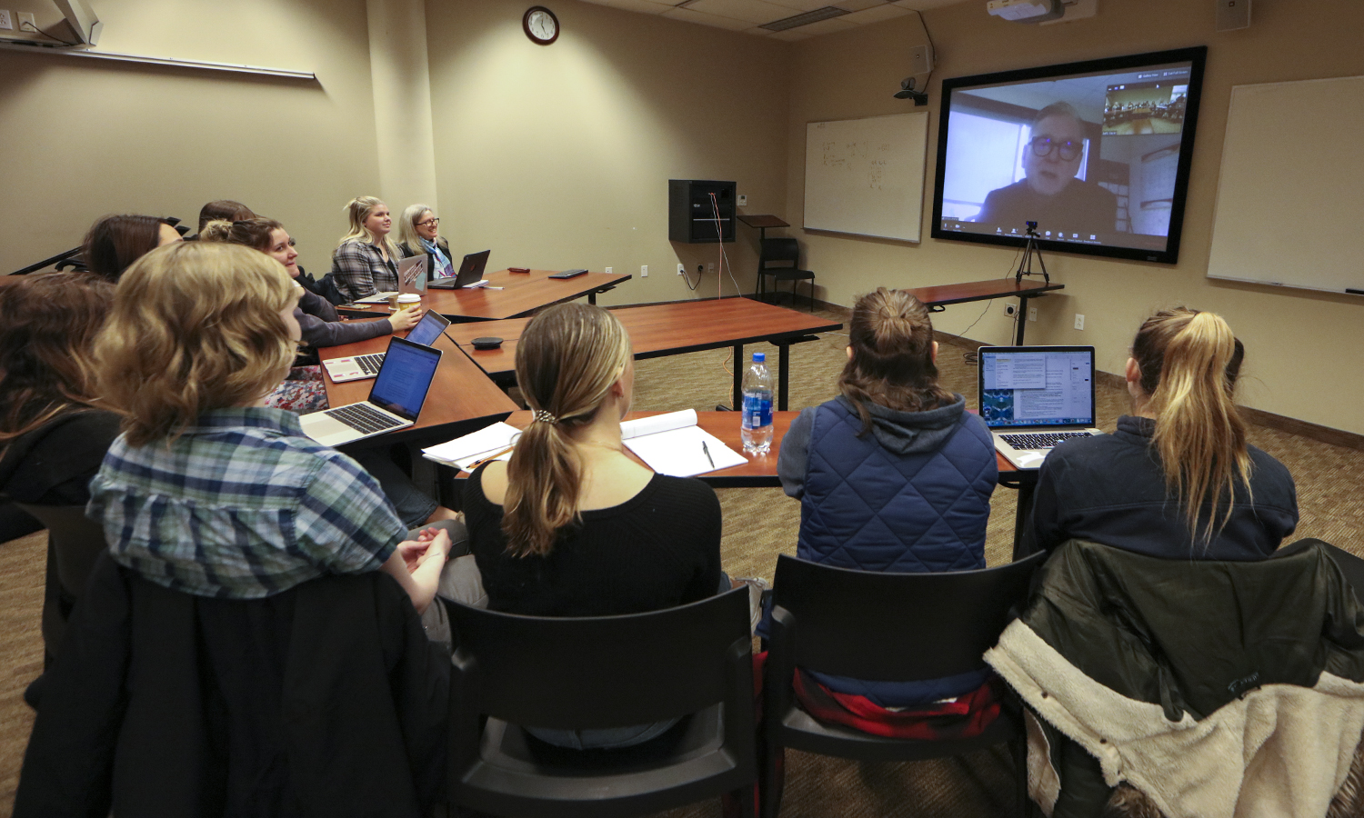 "Students in ""xxx"" with Professor of Women's Studies Betty Bayer hold a Skype session with executive producer of the ""The Handmaid's Tale"" Warren Littlefield '74. Littlefield discussed adapting Margaret Atwood's book for TV audiences, working with Elizabeth Moss, Ann Dowd and Bruce Miller to bring the story to life, and how social and political context influence the series."