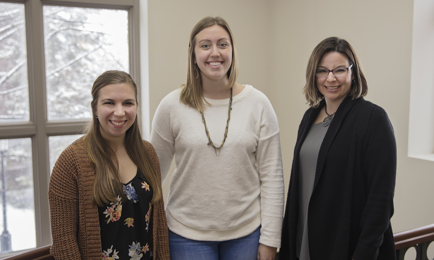 Elizabeth Hawes '19, Kelsey Arroyo '18 and Associate Professor of Psychology Jamie Bodenlos gather for a photo in Gulick Hall. Led by Bodenlos, Arroyo and Hawes will be presenting their research on  the role of cognitive fusion on the health of college students at the at the annual conference of the Society of Behavioral Medicine in April.