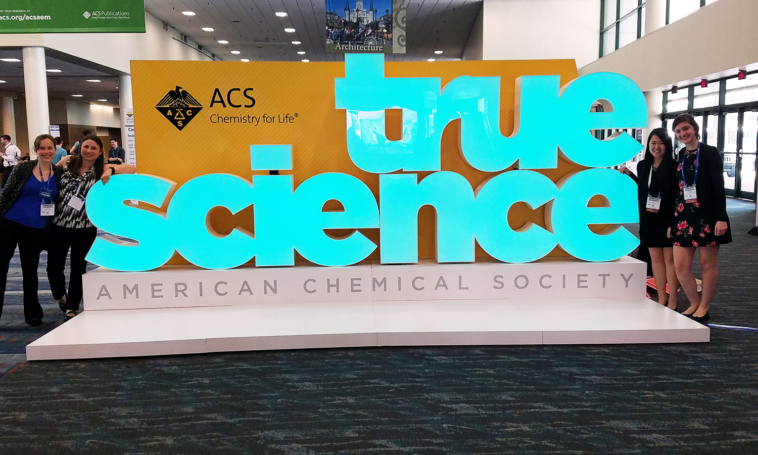 Assistant Professor of Chemistry Elana Stennett (left), Assistant Professor of Chemistry Kristin Slade, Charmaine Chung '19 and Jasmine Jackson ' 20 pose for a photo during the 255th American Chemical Society National Meeting and Exposition in New Orleans, LA.
