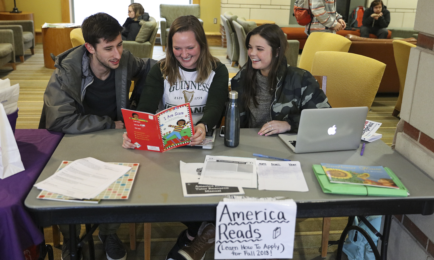 Alex Cottrell '20, Meghan Moore 'X and Brigid Keane table on behalf of the America Reads program on Wednesday afternoon.