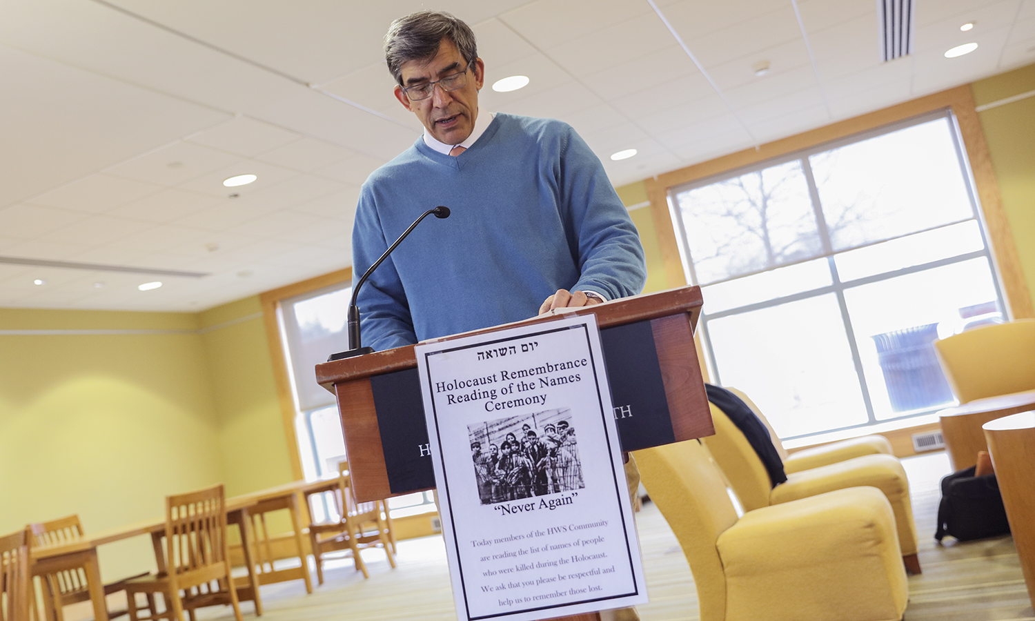 Associate Professor of Religious Studies Richard Salter '86, P'15 reads the names of those lost in the Holocaust as part of Hillel's annual Reading of the names in observance of Yom HaShoah, Holocaust Remembrance Day. Members of the HWS community took turns reading throughout the day.