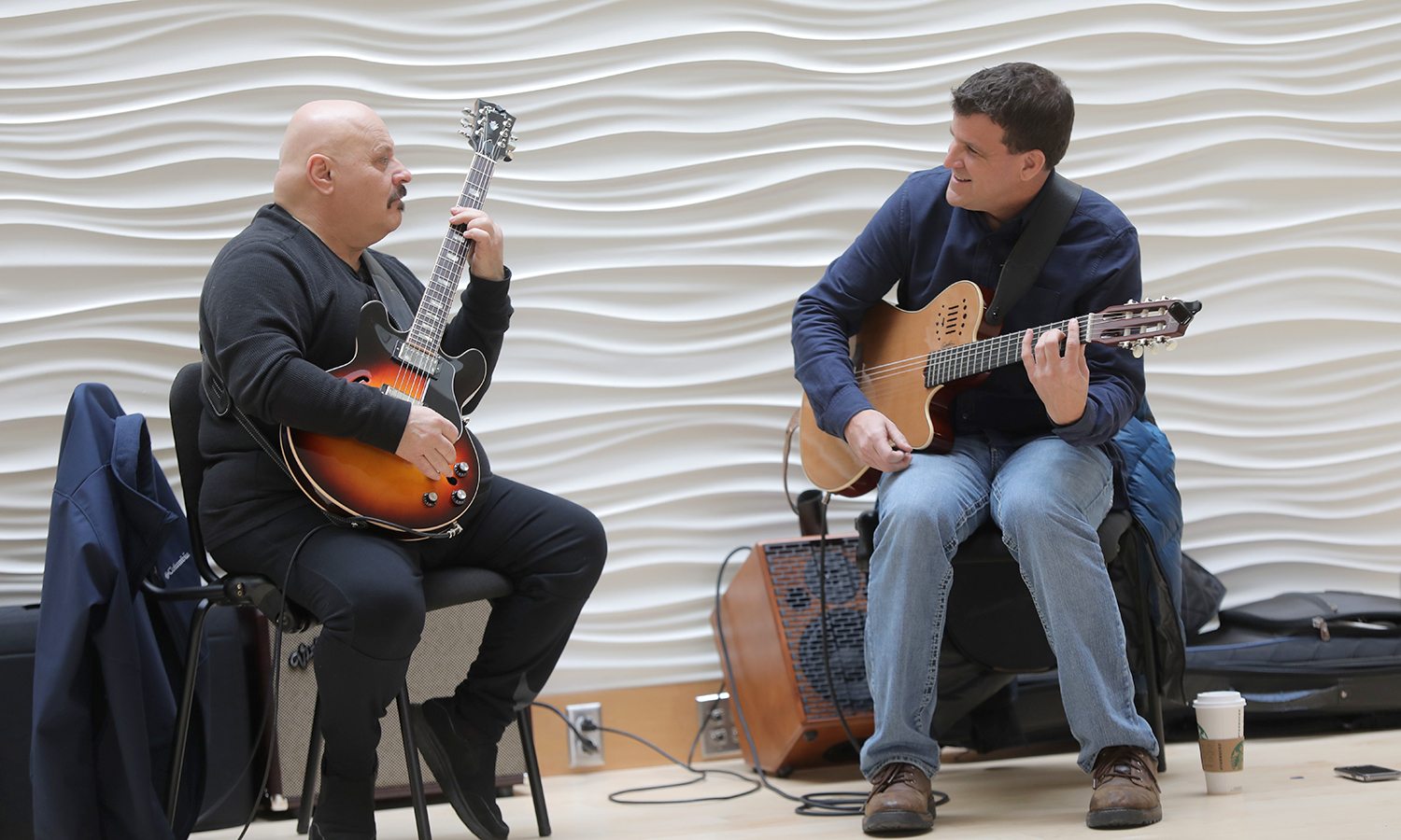 "Rick Balestra (left) performs with Director of the HWS Jazz Guitar Ensemble and Applied Instructor of Jazz Guitar Greg Wachala as part of the ""Jazz n' Guitar"" series in the The L. Thomas Melly '52 Lobby."