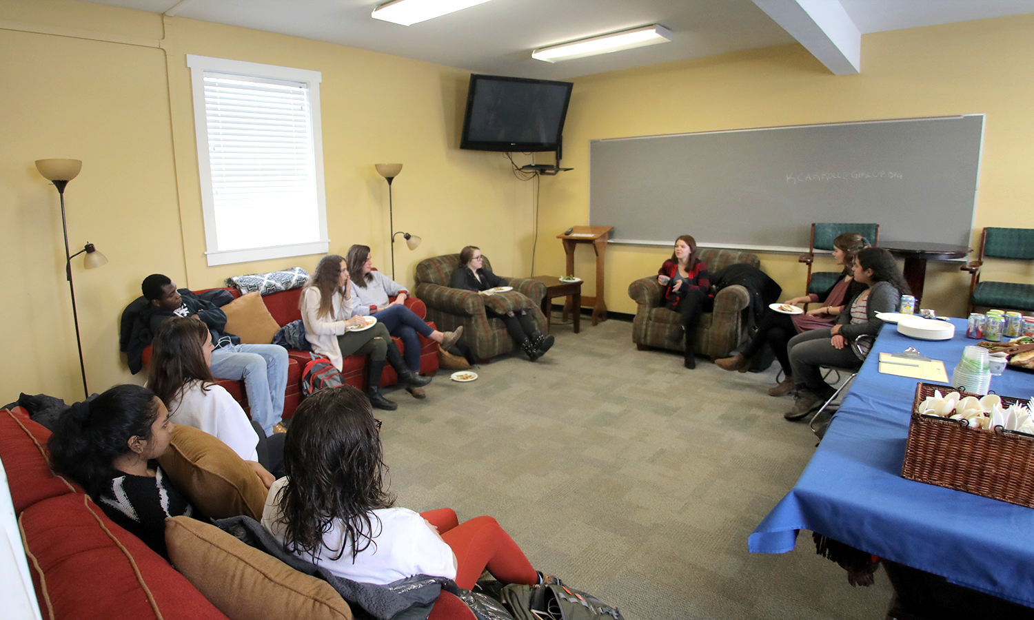 Coordinator for the Universal Access Project at the United Nations Foundation Kelsey Carroll '14 chats with students about life after HWS during lunch in the Office of Intercultural Affairs on Thursday.