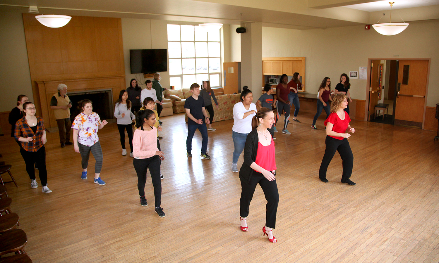 Yahismar Hay (front, left) and Heidi Kraft lead a salsa dancing master class in the Hirshon Ballroom.