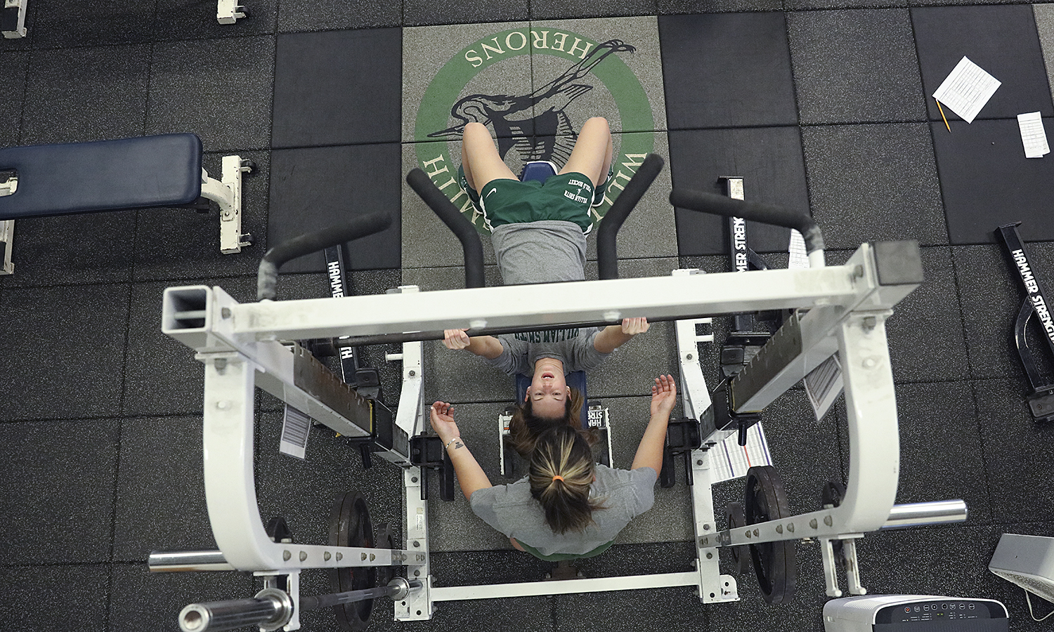 Alexandra Frary 'X spots Kelsey Pierce 'X during weightlifting training in the Raleigh-Foley-Kraus Varsity Strength Training Center in Bristol Gym.