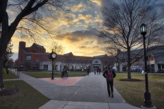 The sun sets over Scandling Campus Center on Tuesday night.