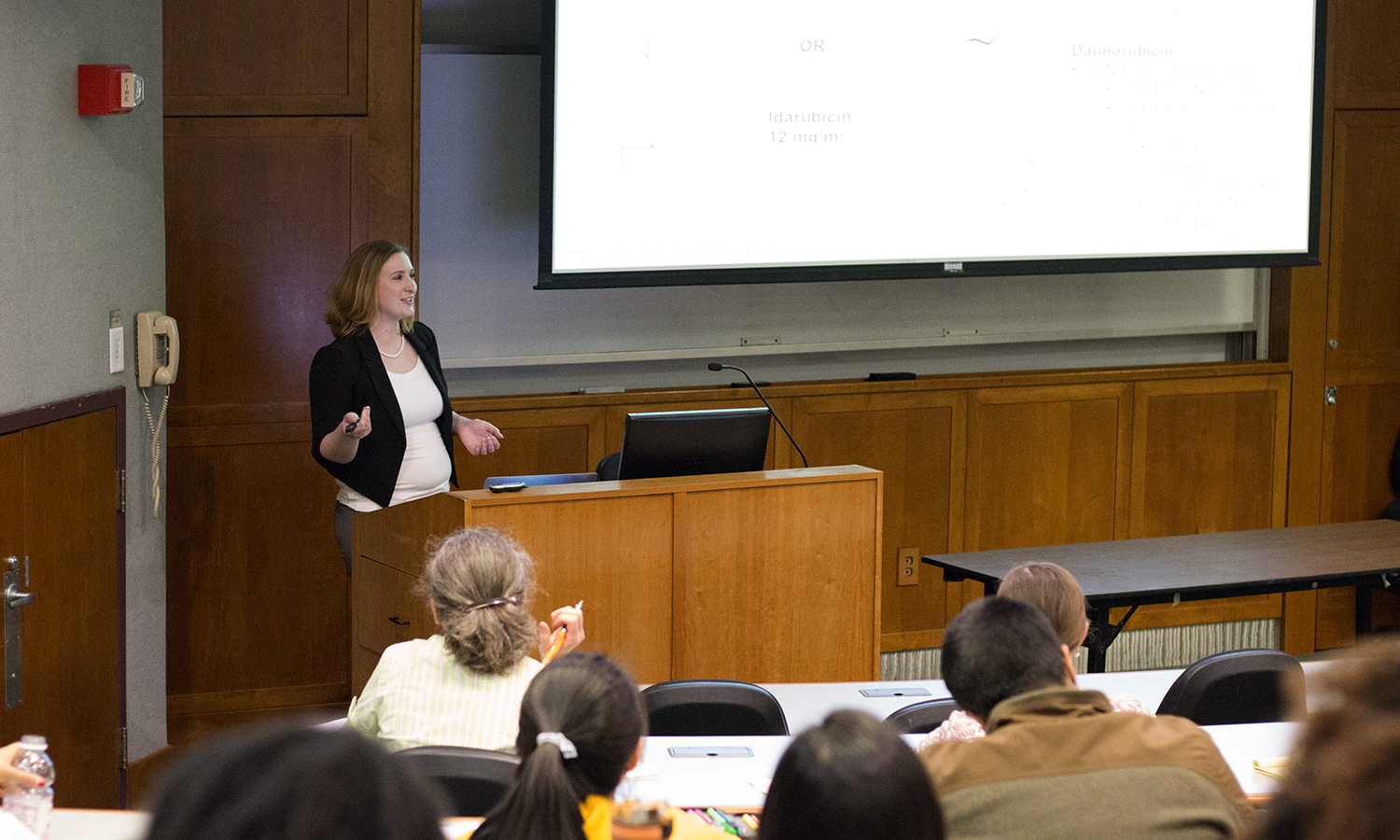 Dr. Kaitlyn Dykstra of the Roswell Park Cancer Institutue discusses her research on acute myeloid leukemia during a seminar in the Sanford Room of Warren Hunting Smith Library.