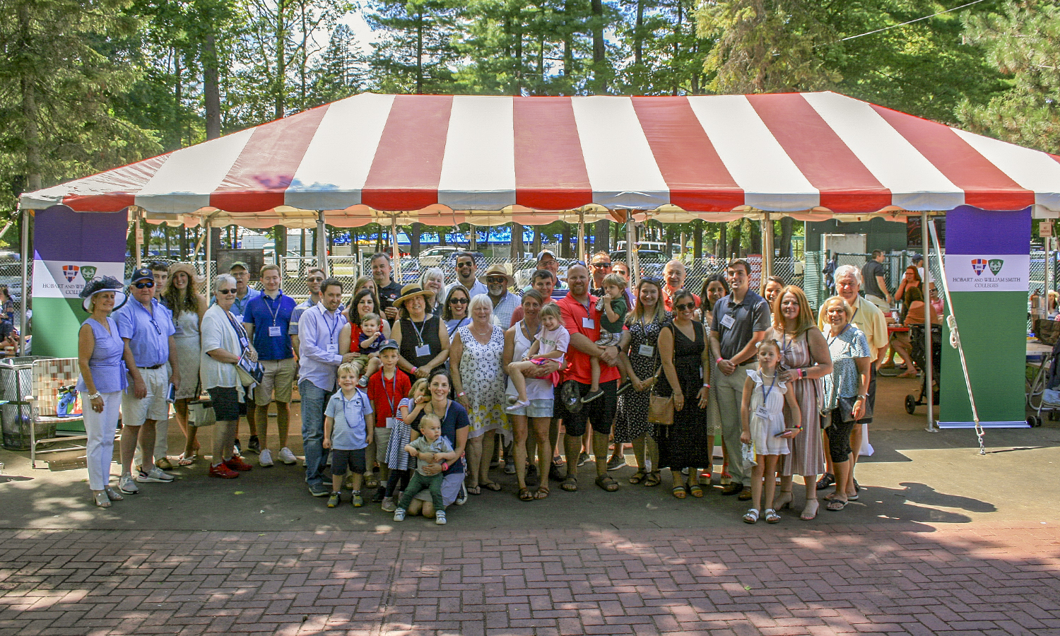 Alums pose with President Joyce P. Jacobsen at the Saratoga Springs, N.Y. Day at the Races event.