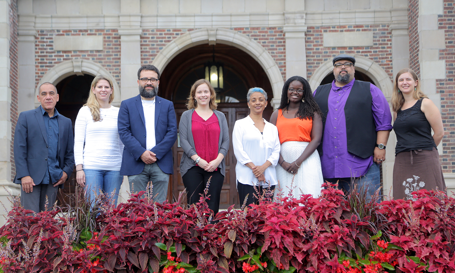 New faculty come together for a group photo in front of Coxe Hall during the new faculty orientation.