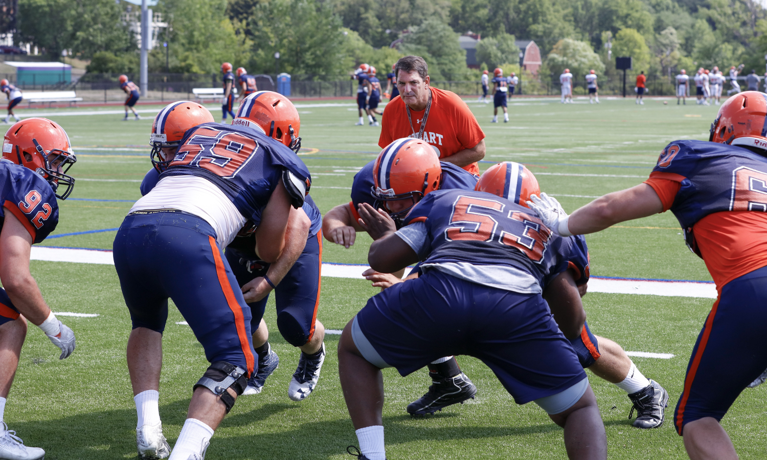 Coach Cragg works with players as practice begins for the Statesmen Football season. Cragg began with Hobart as an assistant coach in 1986, and became head coach in 1995.
