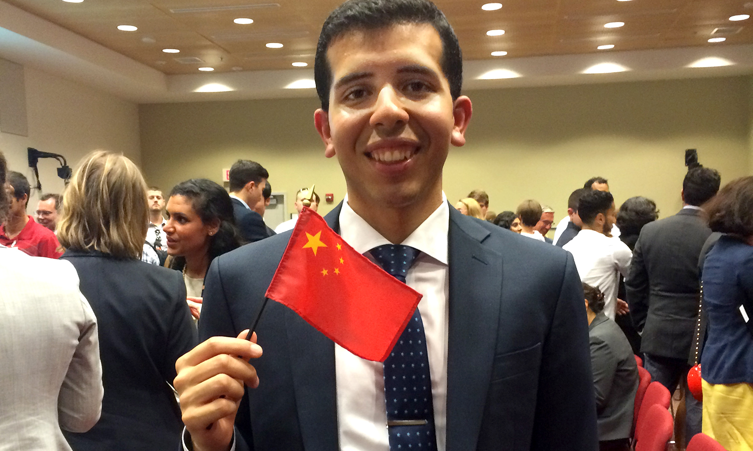 David Luna '14 participates in a flag ceremony in Washington, D.C., before leaving for Beijing, China for a consular tour and other diplomatic training. Luna is set to work at the U.S. Embassy in Beijing, where he interned in 2015 as a Rangel Fellow recipient.