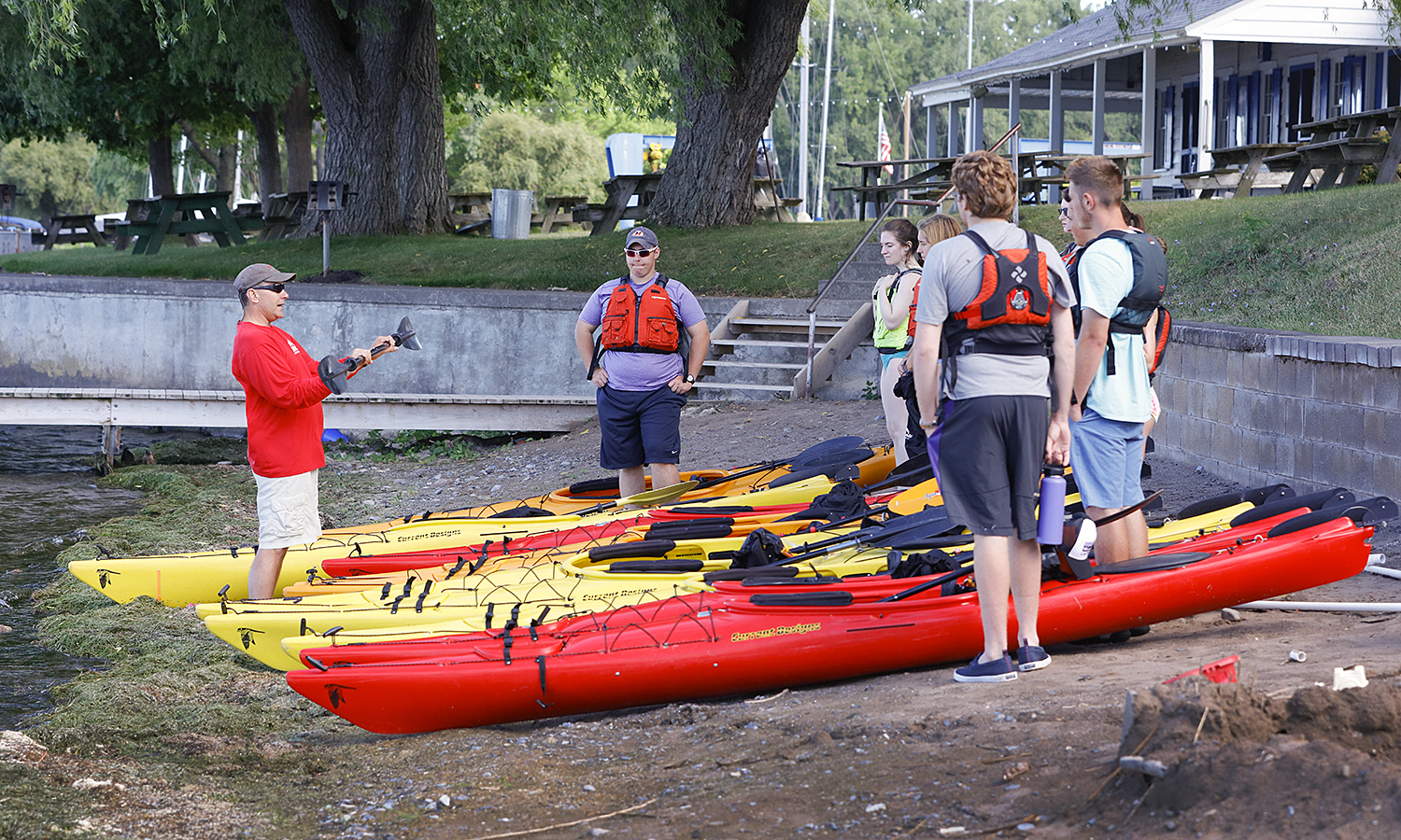 Dean Mapstone goes over intructions on kayaking before the POAP SAtudents hit the water.