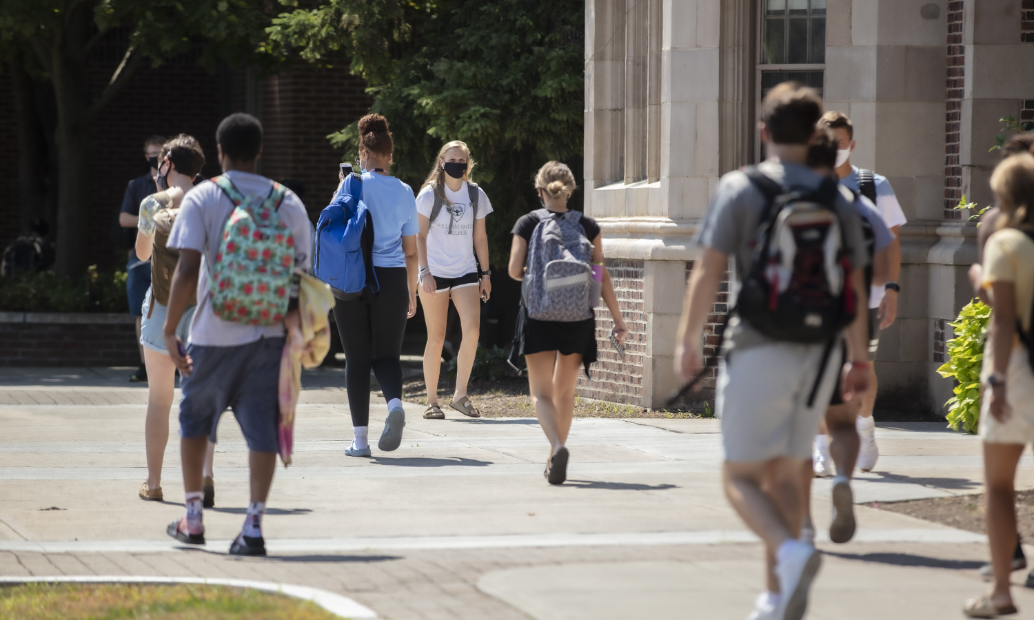 Students walk outside of Coxe Hall.