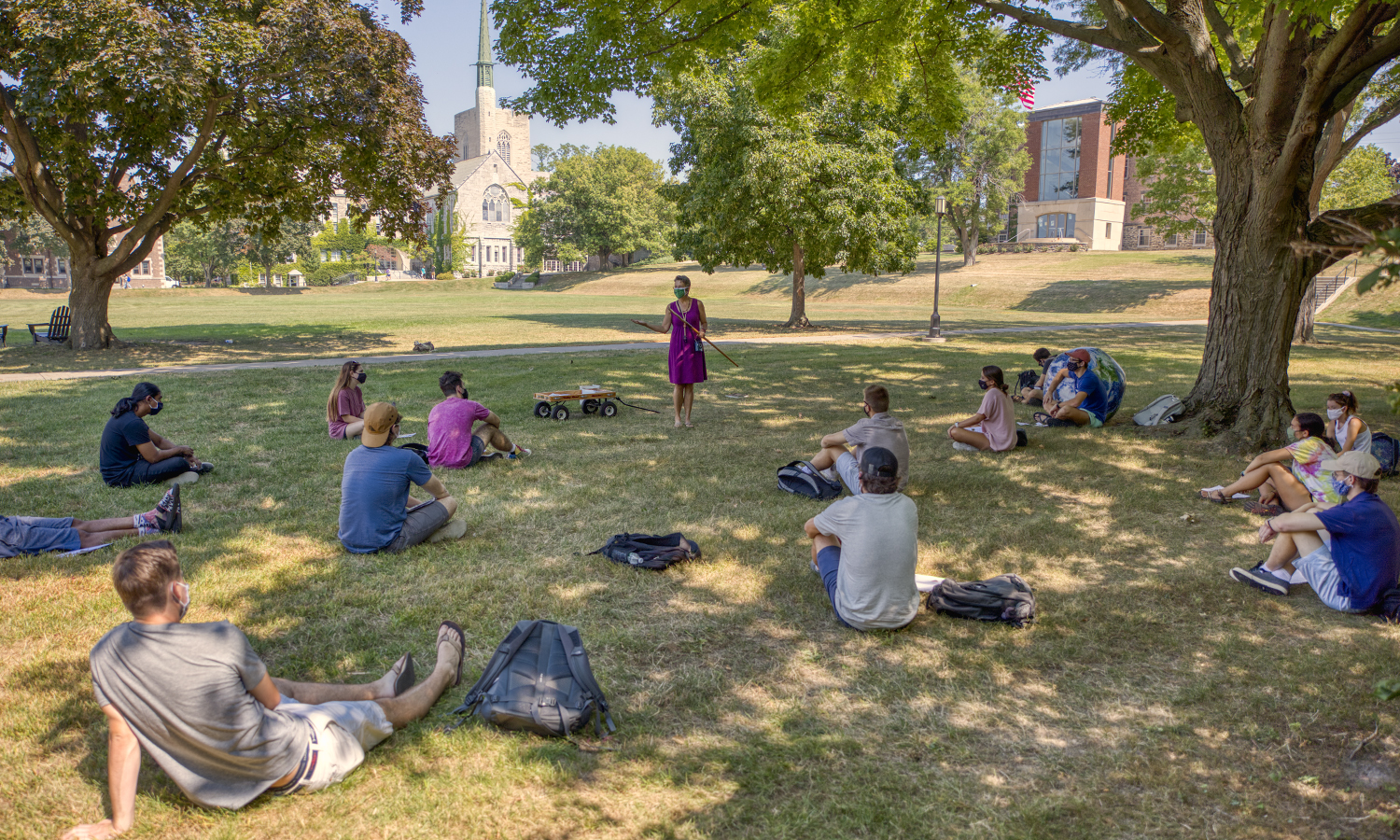 "Professor of Geoscience Nan Crystal Arens teaches on the Quad during ""Earth History."" ""Rocks tell stories about the past, if we know how to read the record,"" Arens said during her lecture."