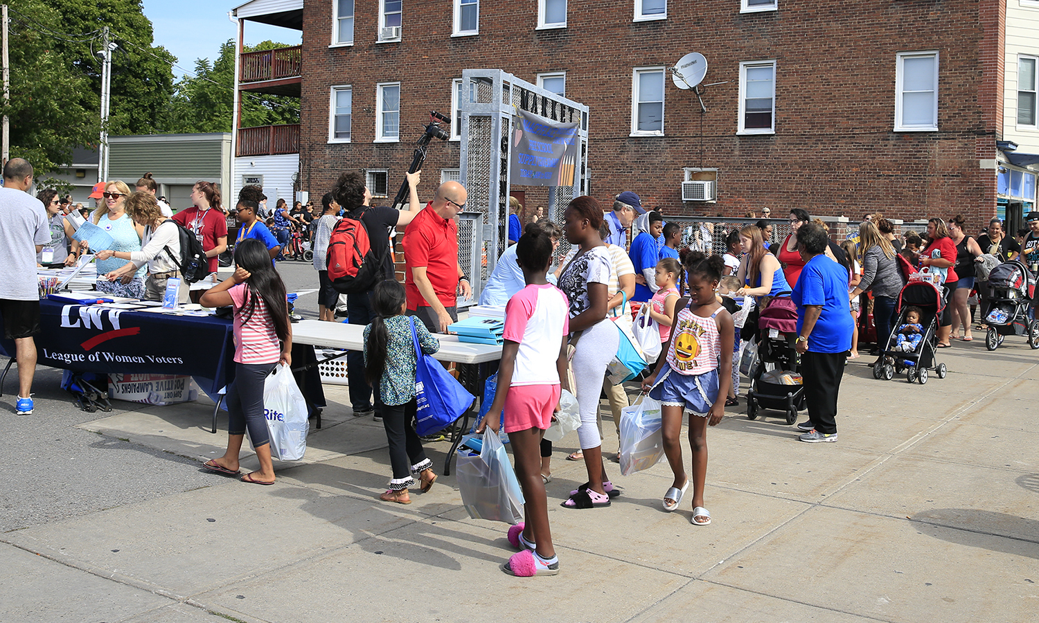 First-years partner with members of the NAACP at the annual Backpack Program to distribute free school supplies to elementary through high-school students during the 2018 Day of Service.