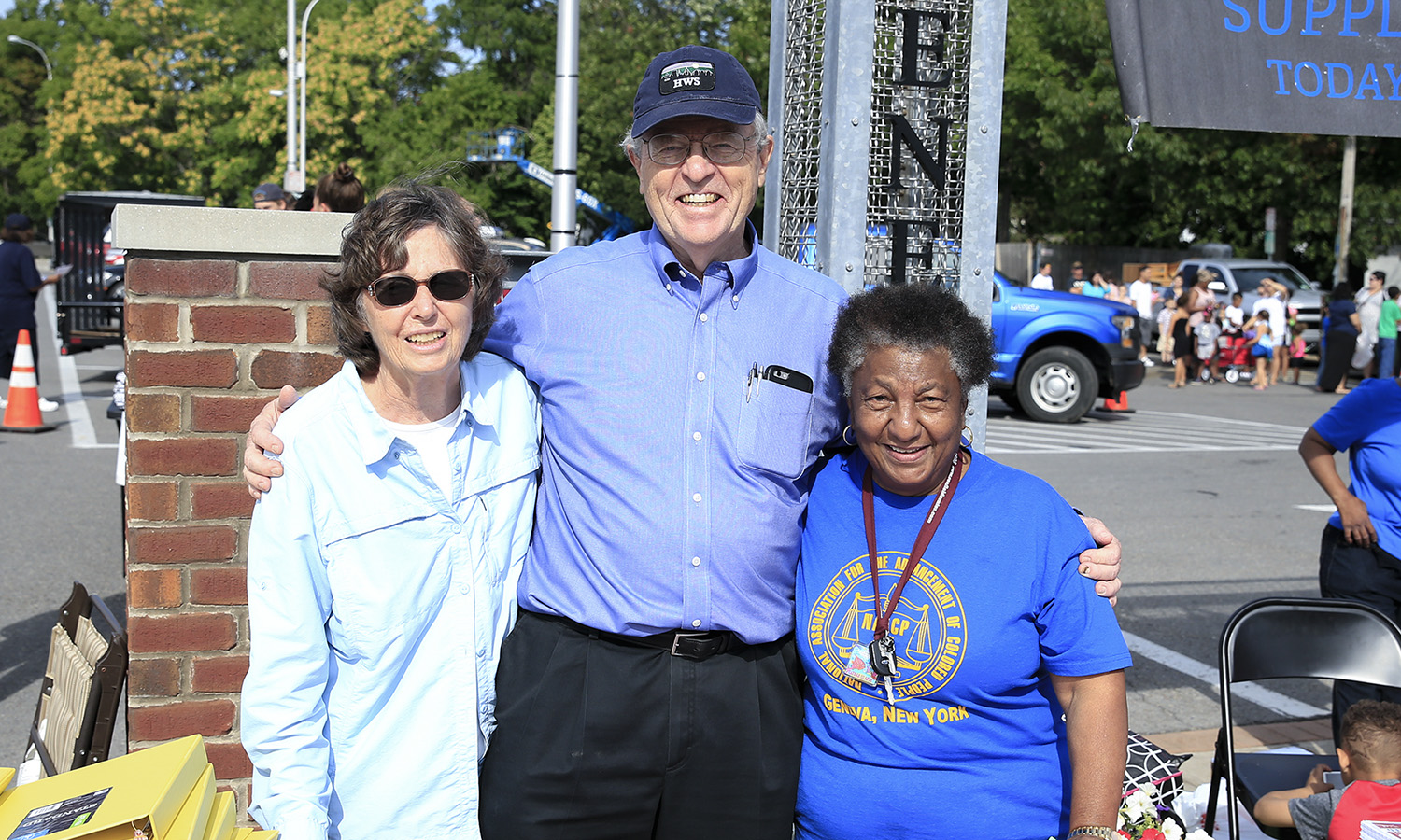 Interim President Patrick A. McGuire L.H.D. '12 and his wife Sandra McGuire pose with the president of the Geneva, NY chapter of the NAACP and resource coordinator for the Canandaigua City (N.Y.) Court system Lucile Mallard during the 2018 Day of Service Backpack Program.