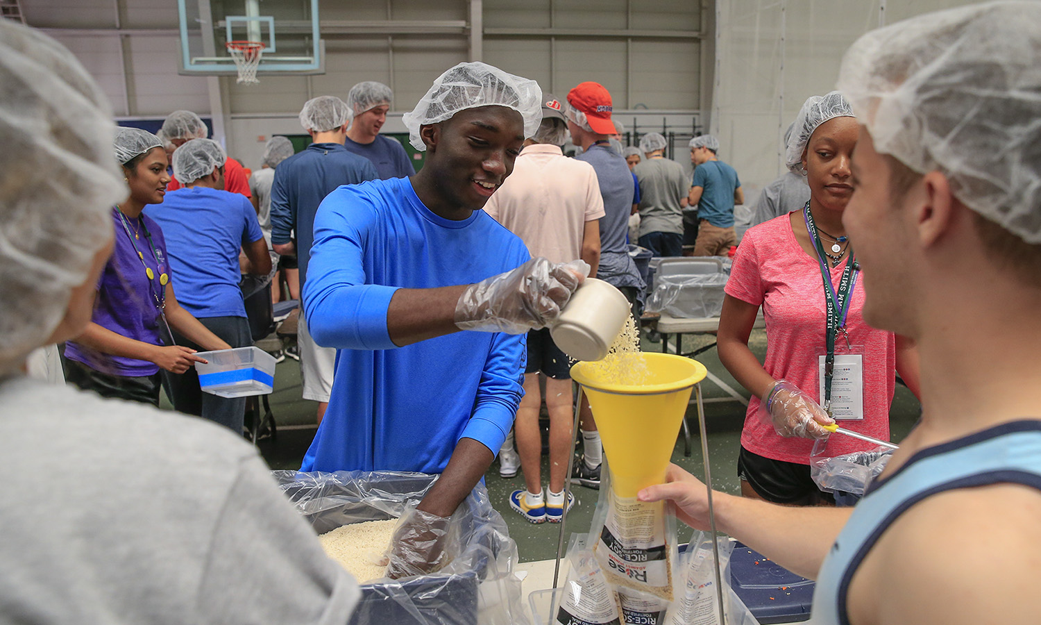 During the 2018 Day of Service, Michael Bamah '22 packages meals at Bristol Feild House for delivery to poverty-stricken areas around the world. The event was coordinated in conjunction with Rise Against Hunger, the international relief organization.